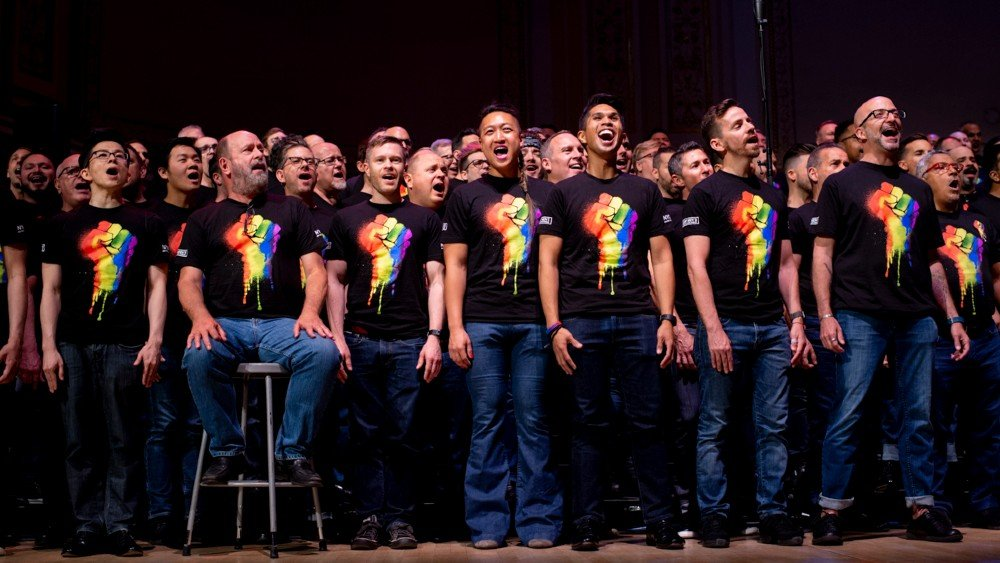 New York City Gay Mens Chorus singing in rainbow pride shirts