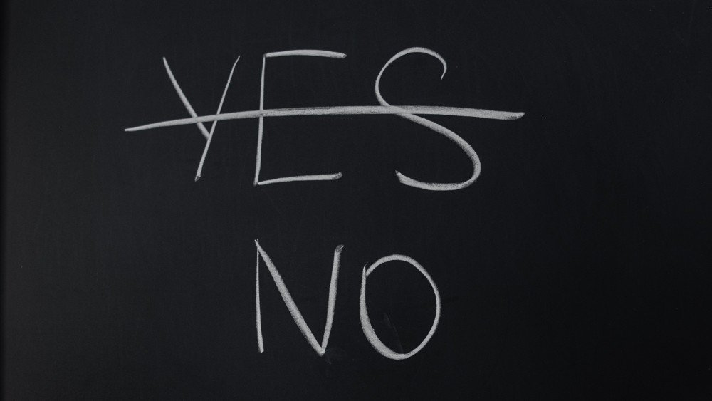 chalkboard with yes crossed out and no below