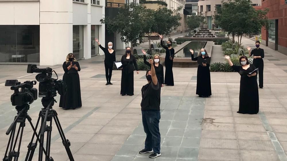 filming vox femina singers masked